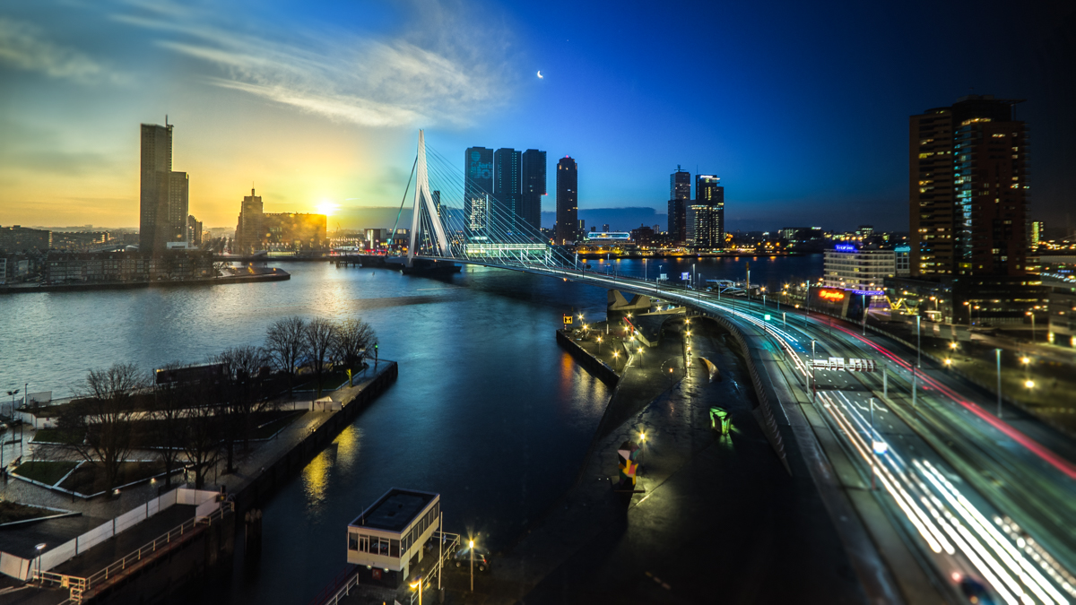 Slow (II) – Time Shift of a whole winter night from 10pm (right) to sunrise at 9am (left) at the Erasmus Bridge in Rotterdam, The Netherlands