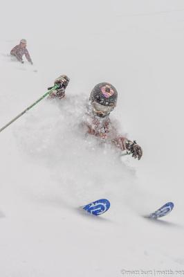 Powder skiing boy