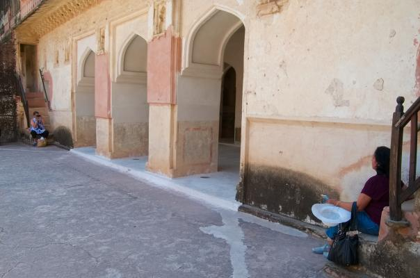 Two weary travelers, too tired to stand up and click or pose, at Amer palace in Amer Fort, Jaipur, Rajasthan, India.