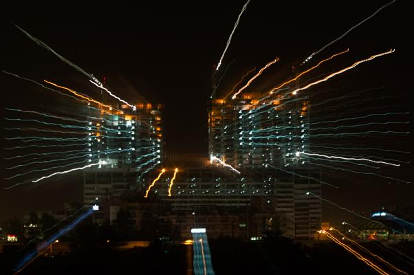 Animating a night scene by zooming during a long exposure.