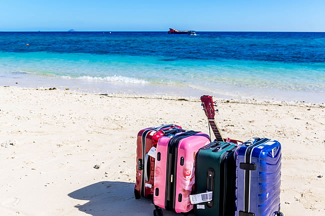 Baggage on sand at Bounty Island
