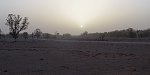 2 December 2019 - the sun sinks into the dust at Mosquito Creek. Pentax Q7 SOOC except for cropping.