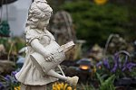 March 24: Garden cherub with watering can  Dreary rainy weather, squelching foot steps, and water dripping on the non-weather sealed body......