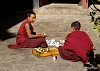-young-monks-cleaning-out-candlewax..jpg