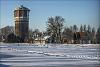 Old watertower across frozen canal