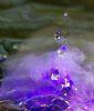 Droplets in a Purple Mist