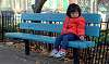 Daughter on park bench