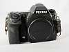 Pentax K-7 with Battery but no Charger. Works well.