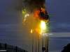 Electricity pylon exploding and catching fire