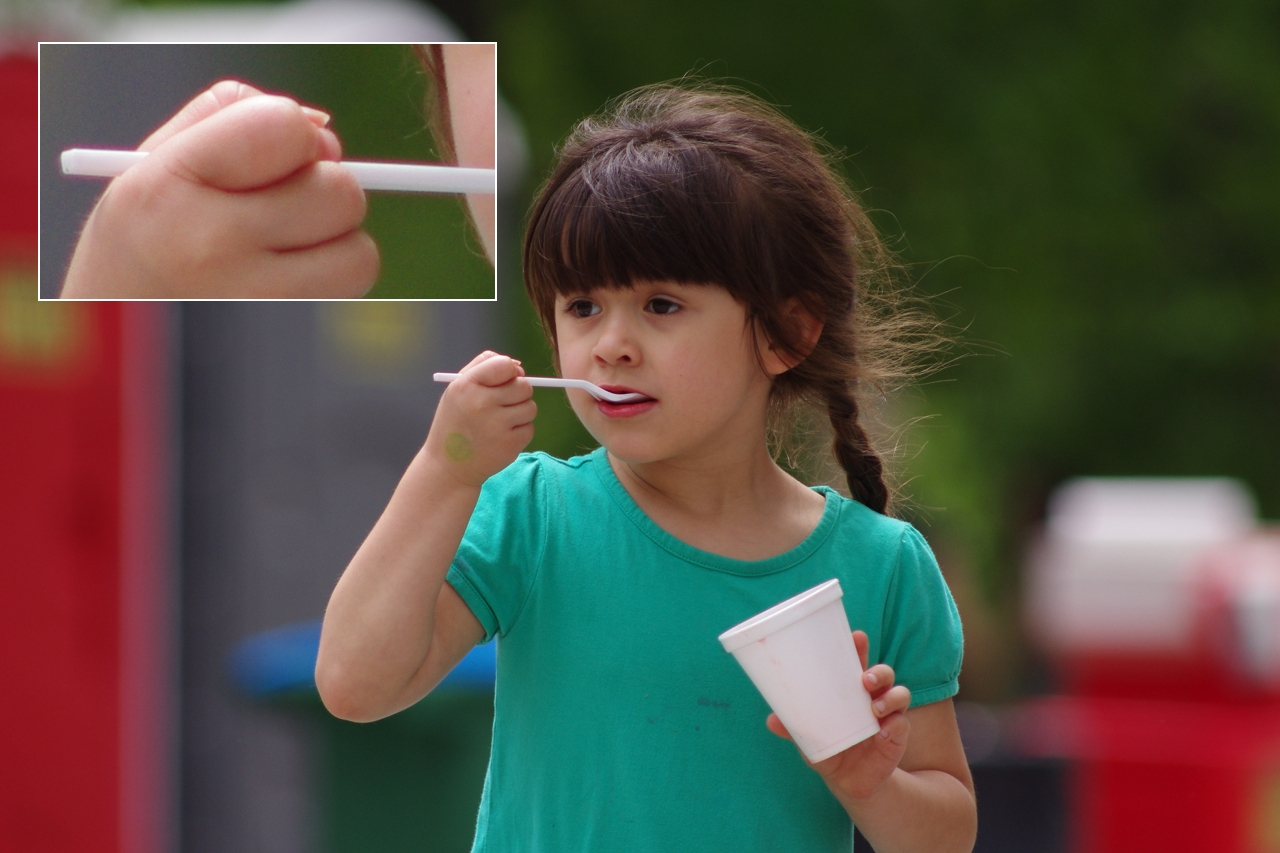 A Merriam girl finishes an ice cream treat at the city's 2013 Turkey Creek Festival at Antioch Park. The inset photo is a 1:1 enlargement showing the slight purple fringing of the high contrast area in the image.