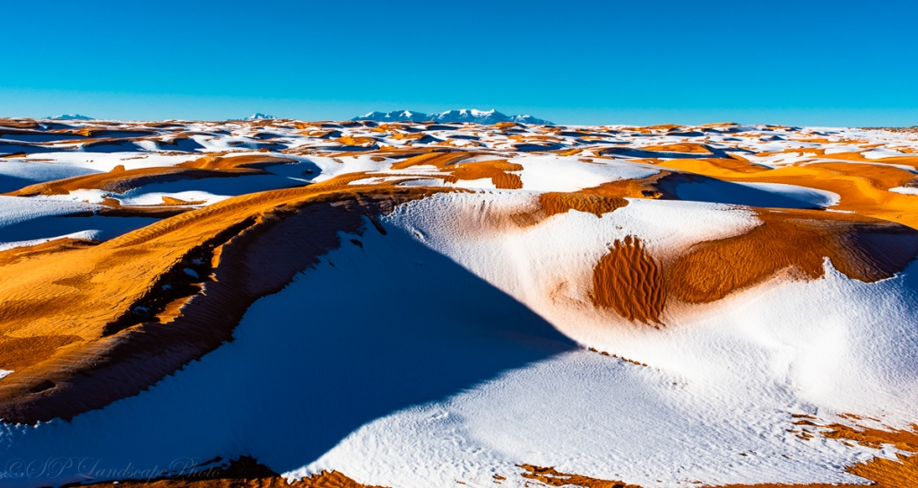 Snowy Dunes and the Henry Mountains