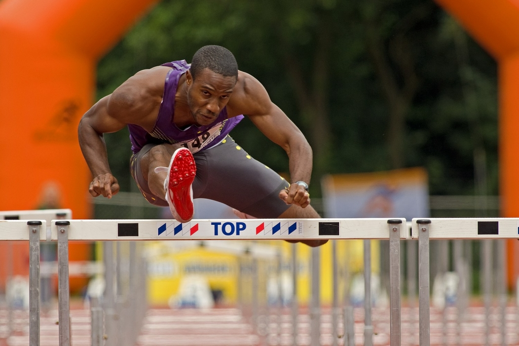 Gregory Sedoc flies over the hurdles